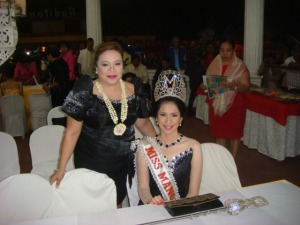 LADIES OF THE NIGHT IN BLACK: Mangaldan Mayor Bonafe de Vera-Parayno strikes a pose with last year's winner of Miss Mangaldan during the coronation night of Mrs. Mangaldan held at the public plaza in the night of March 8.